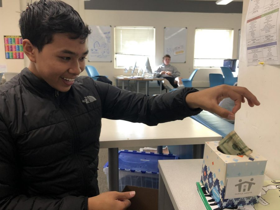 Junior Adam Beltran joins several other Redwood students by donating money to the Family House organization.