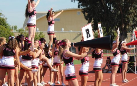 Performing in front of packed stands, the Redwood cheerleaders display their support for the football team in the homecoming game against San Rafael High School, just hours before the PG&E power outages began which caused the homecoming dance to be cancelled.
