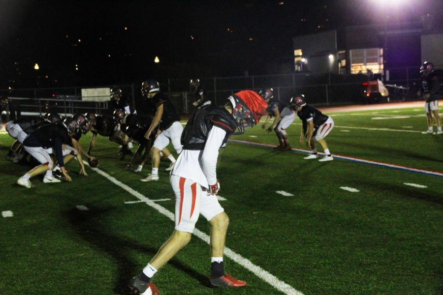 The Redwood varsity football team prepares for the playoffs underneath their newly rented lights
