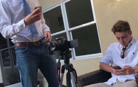 Creating a new video, Matt Shippey and Callaway Allen look over their scripts.