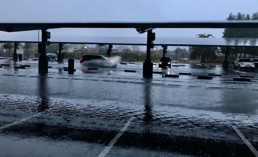 The front parking lot was flooded this morning due to heavy rains that are expected to continue throughout the week.