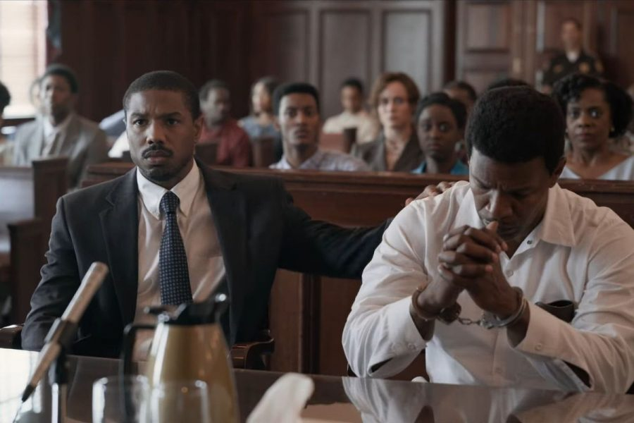 "Image courtesy of Vox. Bryan Stevenson (Michael B. Jordan) comforts Walter ""Johnny D."" McMillian (Jamie Foxx) after their first attempt to appeal McMillian's case."