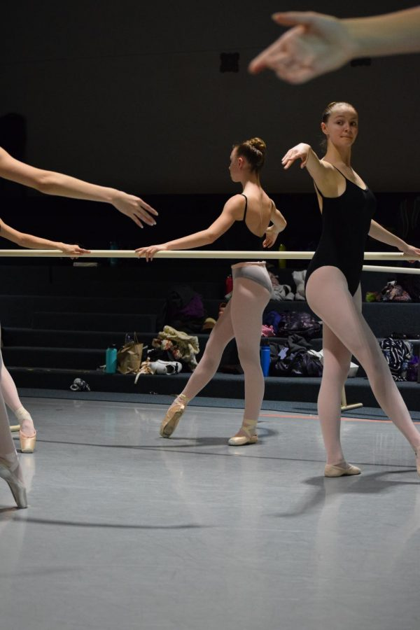 Redmond and her classmates practice a combination at the barre.