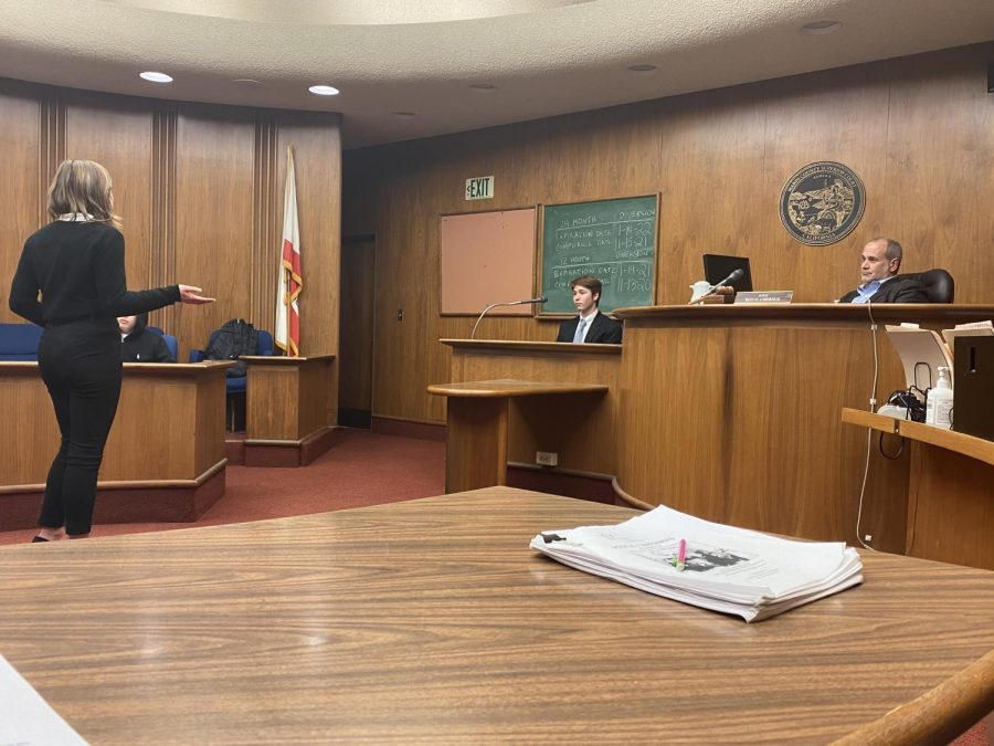 Listening to the opposing lawyer speak during cross examination, the Redwood Mock Trial team prepares in a scrimmage at the Marin County Courthouse for their competitions on Jan. 25 and Feb. 1.