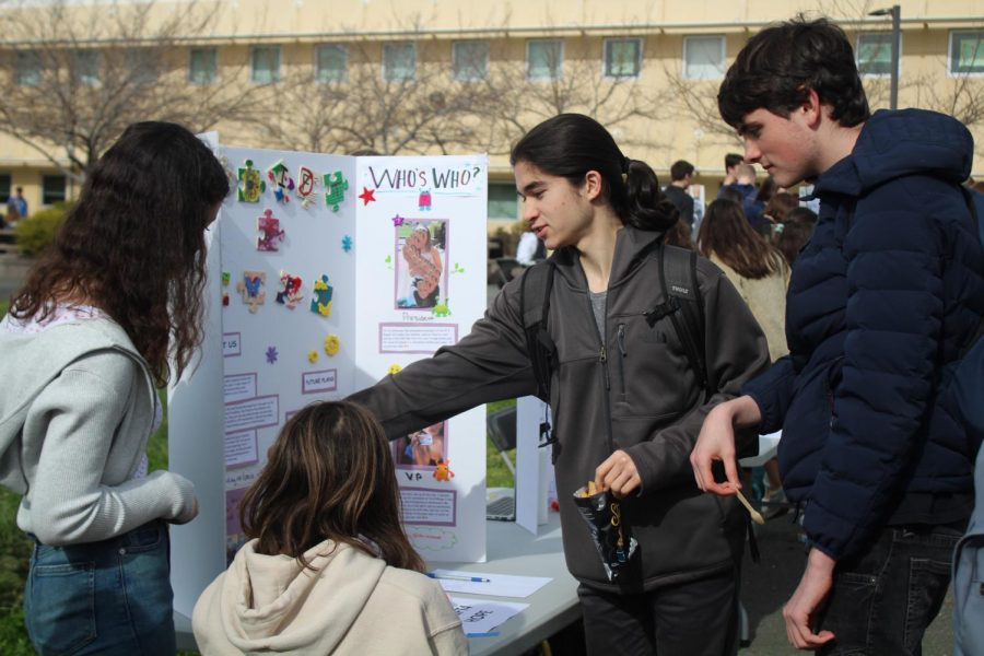 At Club Day, students advertise their clubs while potential new members sign up.
