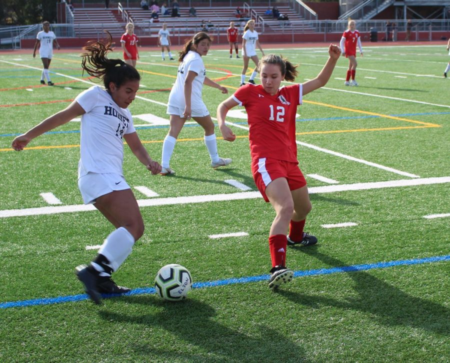 Girls' varsity soccer cruise their way to a victory despite the absence of their coach
