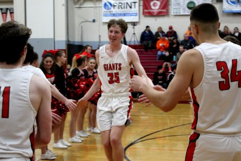 Freshman Ains Fish shines on the Varsity Boys' basketball team