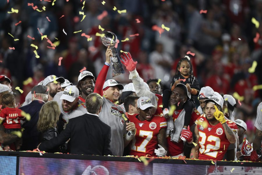 Hoisting the Lombardi Trophy, Patrick Mahomes celebrates the Super Bowl victory with his teammates.
