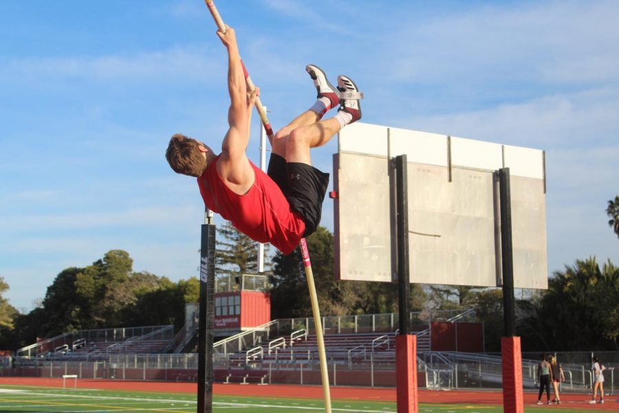Pole vaulter and junior Jackson Moseley propels himself more than ten feet in the air.