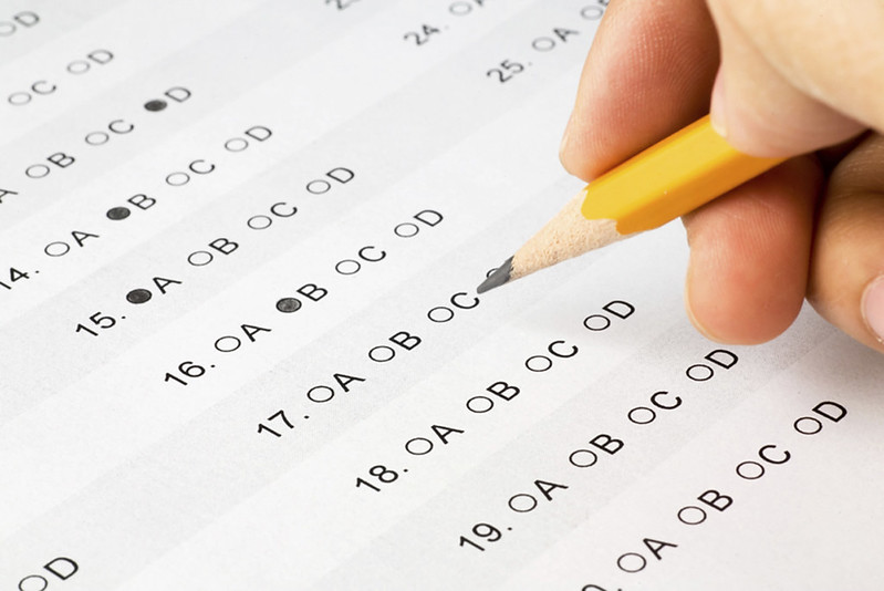 Student taking standardized test. Photo credit to Flickr website and Alberto G.