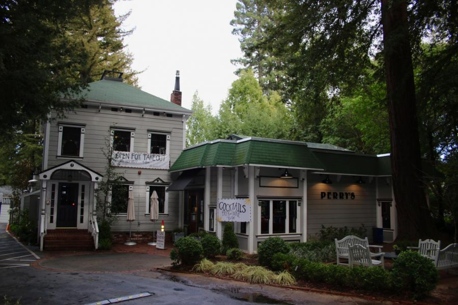 Surrounded by towering redwoods in downtown Larkspur lies the 'haunted' building which now accompanies  Perry's on Magnolia.