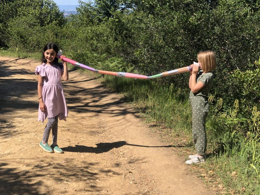 While walking on a Mill Valley trail, two girls spoke through their homemade 6ft apart communication device.
