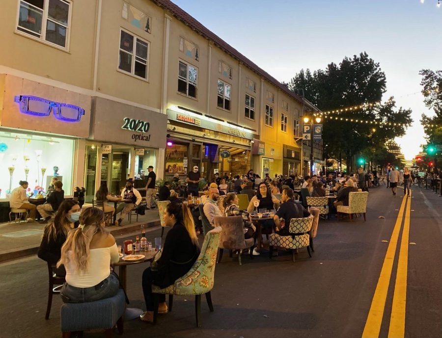 People enjoy dinner at Dining Under the Lights in San Rafael, an outdoor on-street dining alternative during COVID-19.