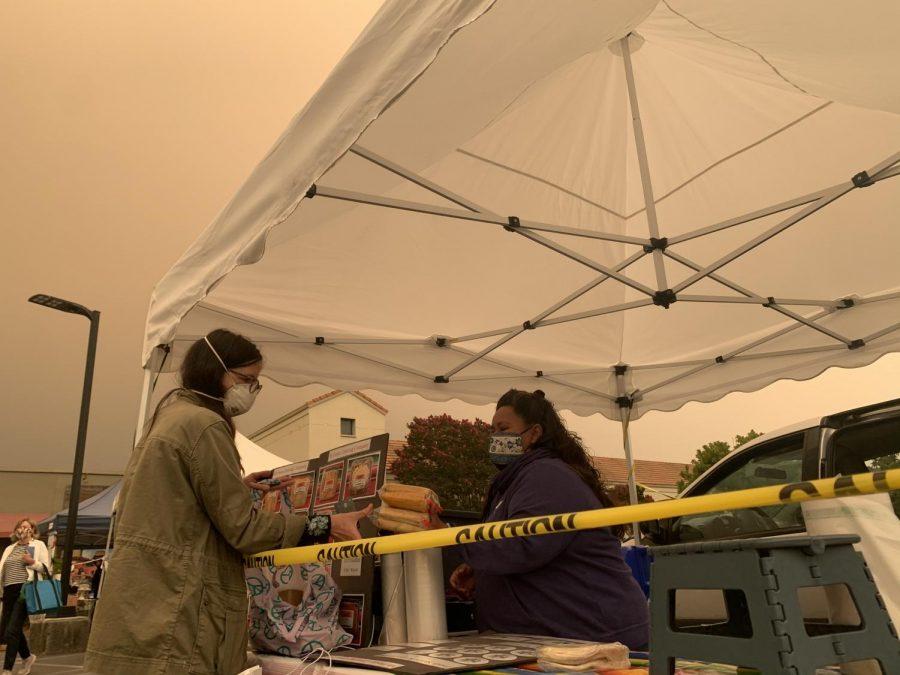 Vendor, Alicia Perez, sells tamales at the Town Center Farmer's Market.
