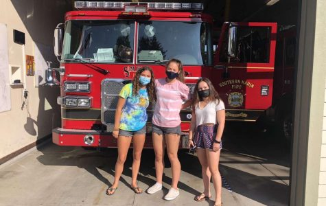 Zirpoli, Ryning and Rothbart gather at the fire station after delivering their first round of cookies