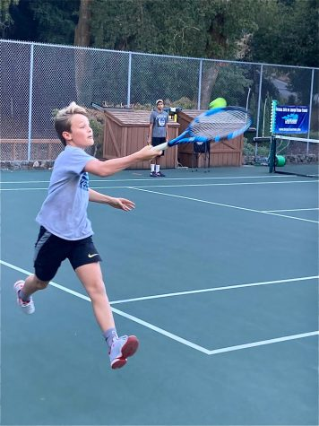 Just like high school students, elementary and middle schoolers find ways to continue playing sports in places such as local neighborhood tennis courts.