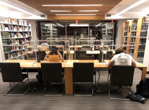 Students study in the Notre Dame Library wearing masks and spaced apart