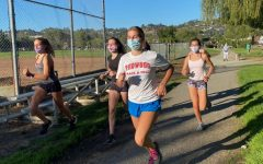 Runners on the cross country team wear their masks while training. (Photo courtesy of Keely Ganong)