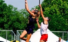 Glass leaps into the air to catch the ball at a college recruiting tournament.