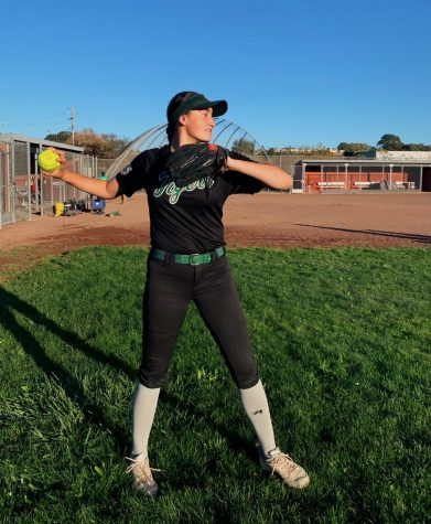 Junior Sadie Leonard throws the ball at her softball practice on Redwood