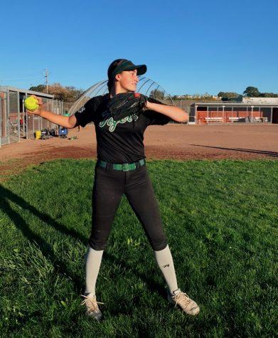 Junior Sadie Leonard throws the ball at her softball practice on Redwood