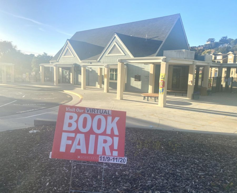 An advertisement for a virtual Scholastic Book Fair is placed outside of Reed Elementary School.