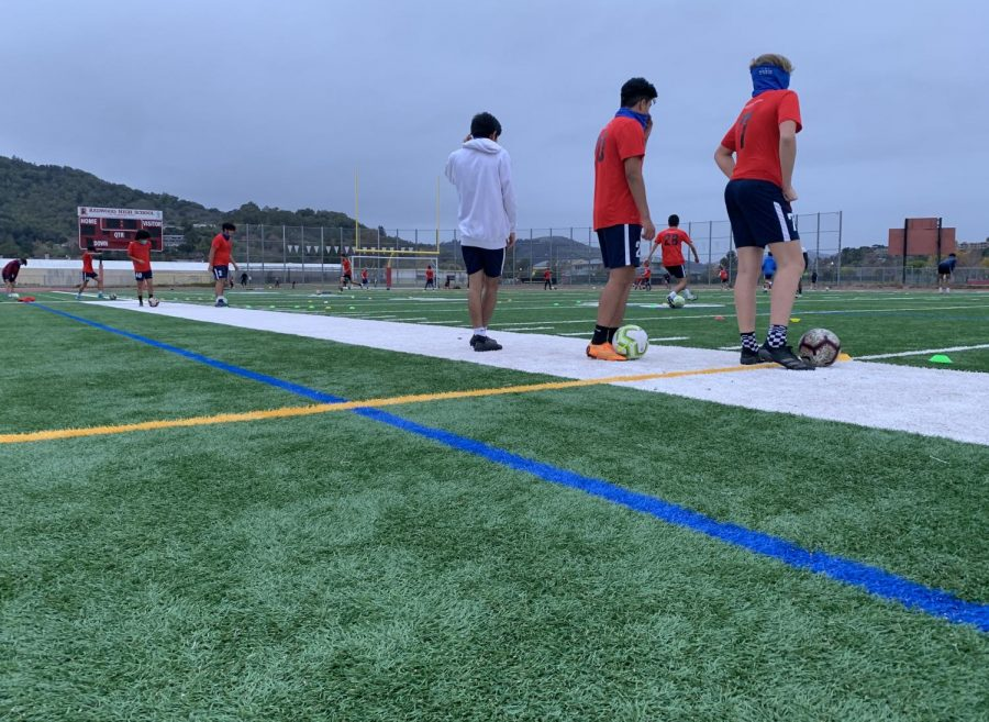 A Marin competitive soccer team practices on the Redwood field on Friday, Dec. 12. Although Marin is currently under lockdown orders, outdoor recreational activities are still permitted.