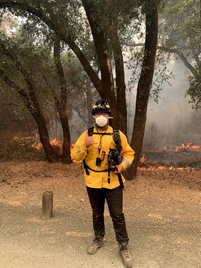 Chris posed beside the Glass Fire fitted in his fire gear (mask, goggles, and protective jacket) before a long day of reporting. (Courtesy of Will Twomey)