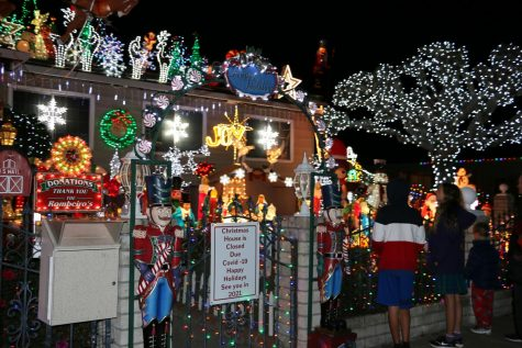 Visitors looking at the Rombeiro Christmas House on Devonshire Drive in Novato, Calif. Edmundo Rombeiro and his family have been putting up extravagant decorations and lights for the past 29 years and even won ABC