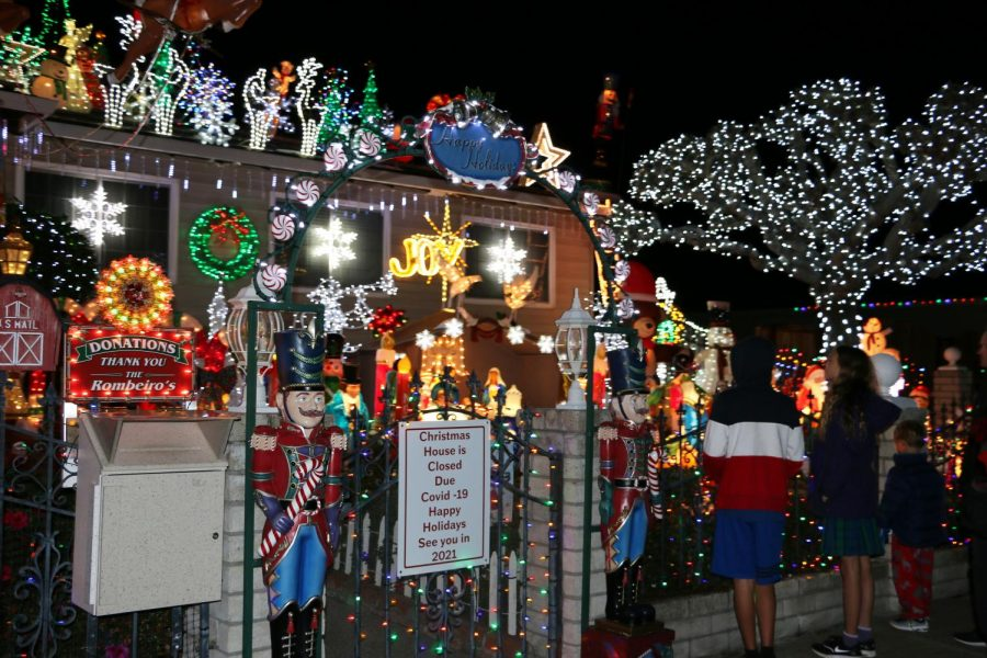 Visitors looking at the Rombeiro Christmas House on Devonshire Drive in Novato, Calif. Edmundo Rombeiro and his family have been putting up extravagant decorations and lights for the past 29 years and even won ABCs The Great Christmas Light Fight in 2019.