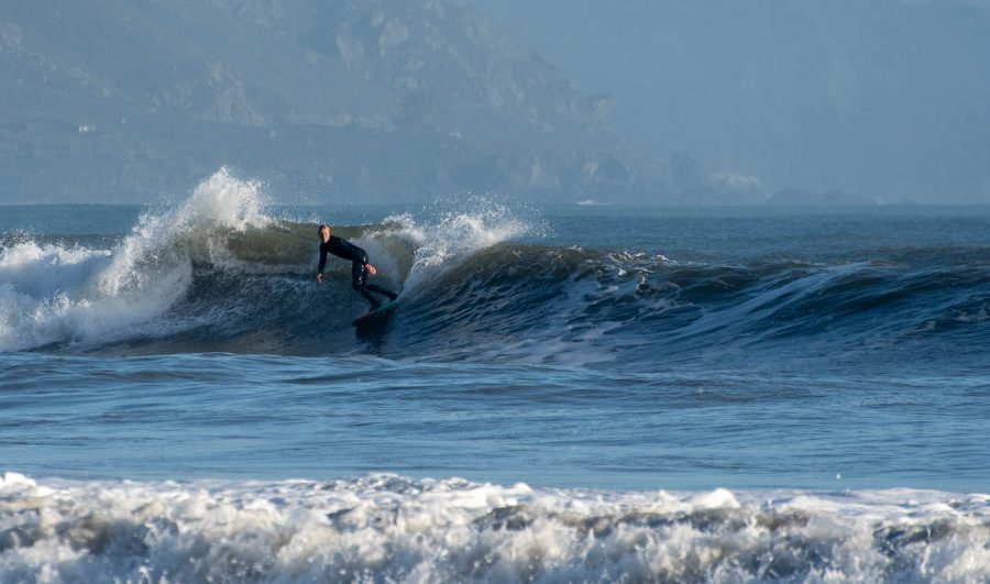 Surfers take to the waters of Bolinas Beach as winter storms are followed by large swells.