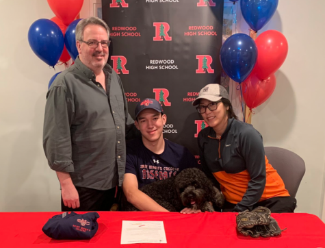 Rice (middle) smiles with his parents on national signing day. Photo courtesy of Sam Rice.
