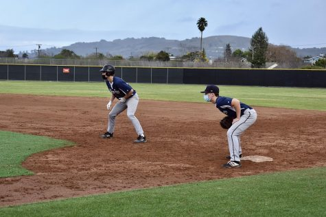 Leading off second base, senior Mikey Bender looks to steal second base.