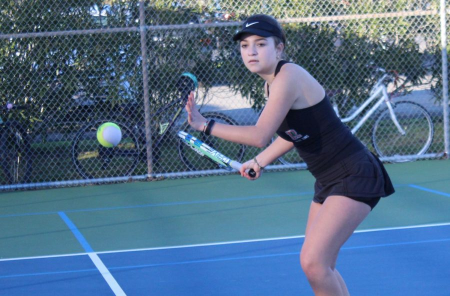 Preparing for tennis tryout that start on Feb. 8, senior Gabriella Rosenfeld practices her forehand at Piper Park tennis courts.