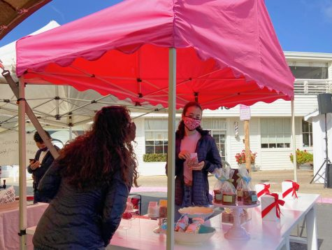 Junior Emily Sigel runs the Miette candy shop stand at the Marin Country Mart Saturday Farmer's Market.
