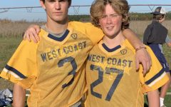Nolan Ewing (left) and Jackson Lesher (right) smile together in their team uniforms Courtesy of Jackson Lesher