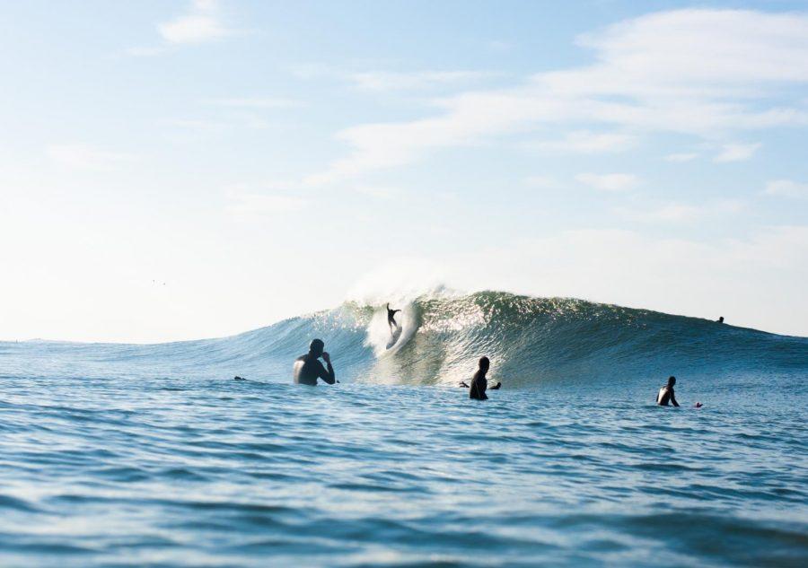 Surfer Charlie Vaughn rides a large wave at Ocean Beach. Photo Courtesy of Jack Bober.