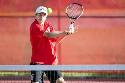 Playing against Tamalpais High School in the 2018 MCAL Tennis Championship, Luke Neal has his eyes on the ball. (Courtesy of Douglas Zimmerman/Special to Marin Independent Journal)