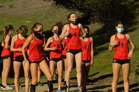 Junior Hailey Connery runs up the ranks of cross country