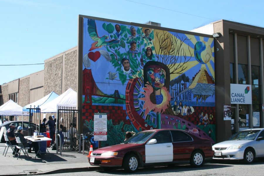 """True Colors"" mural painted outside the Canal Alliance is also a temporary COVID-19 testing center at 91 Larkspur Street."