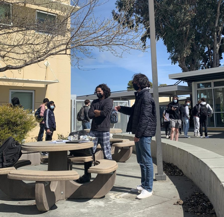 Friends gather outside the CEA for their first lunch on campus in nearly a year.
