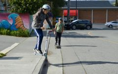 Scootering and skateboarding after school, two Fairfax boys look forward to having a designated space to do their sport that is off the road.