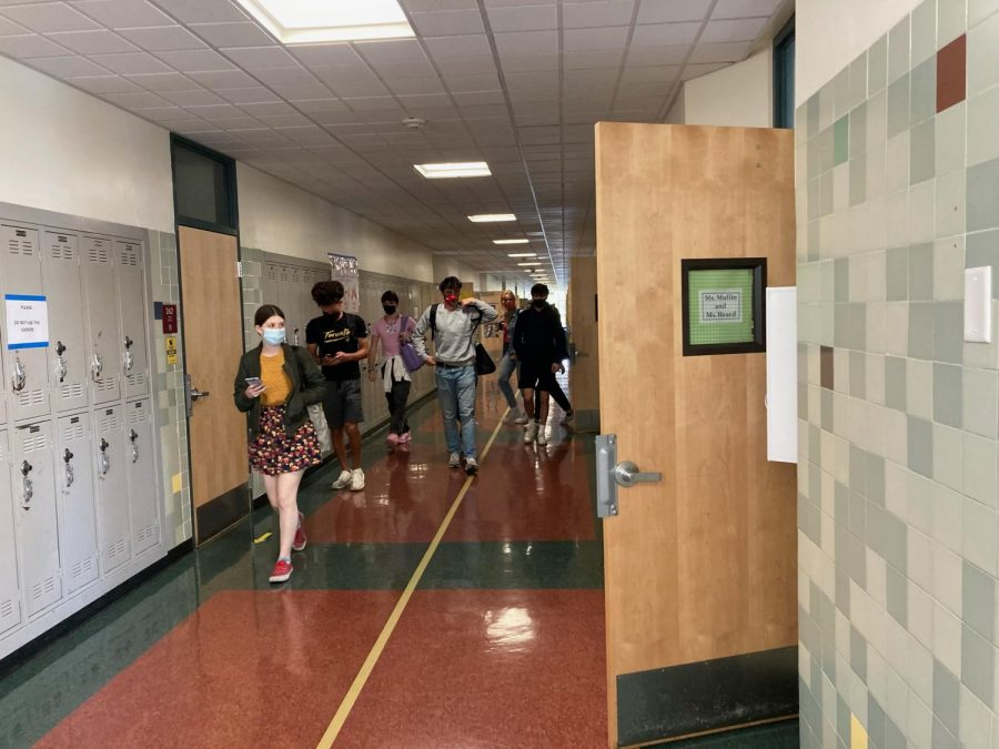 Leaving class after a long day, students follow the hallway arrows out of the building.