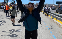 Attending a Black Lives Matter protest, Janneke Byck holds a sign up to show her frustration. Courtesy of Eliza Byck.