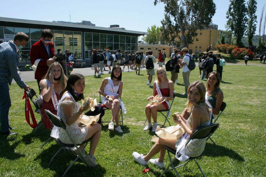 After a live-streamed homecoming crowning, members of the homecoming court enjoy their lunches on the South Lawn.