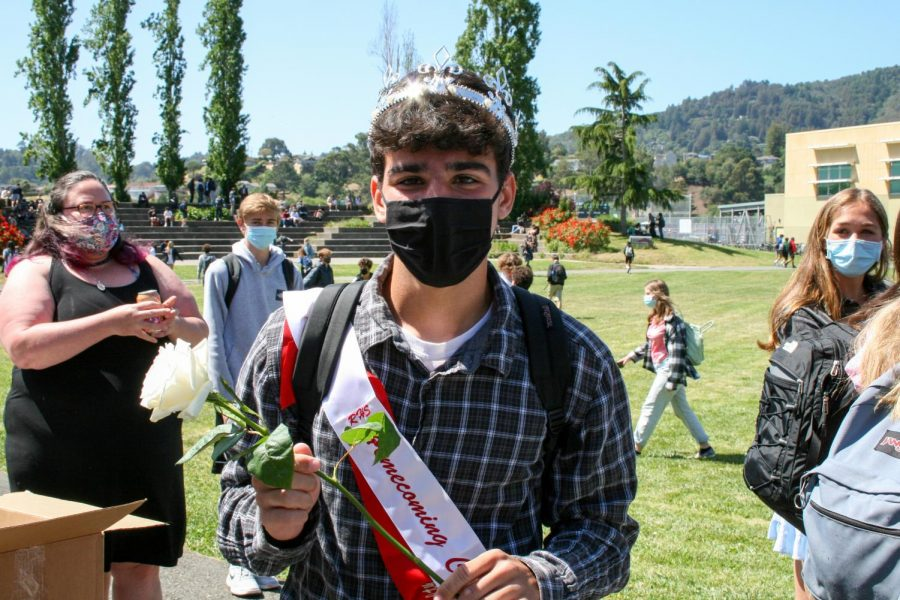 Crowned homecoming royalty over Livestream minutes before, Jackson Epps displays his white rose. Epps is one of two kings this year, along with Marc-Antoine Maync, marking the second year Redwood's royalty has been all male.