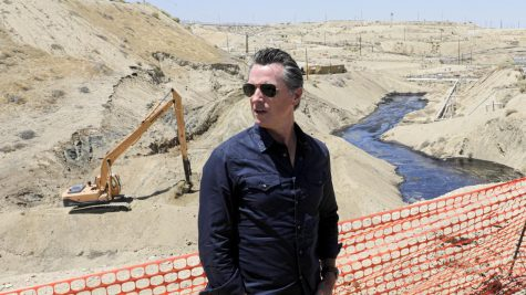 Gov. Gavin Newsom visits a creek in McKittrick, California, where more than 800,000 gallons of oil has been spilled.