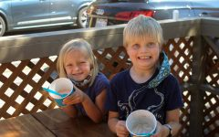 Smiling with their empty bowls, these siblings can't seem to wipe the smiles off their faces.