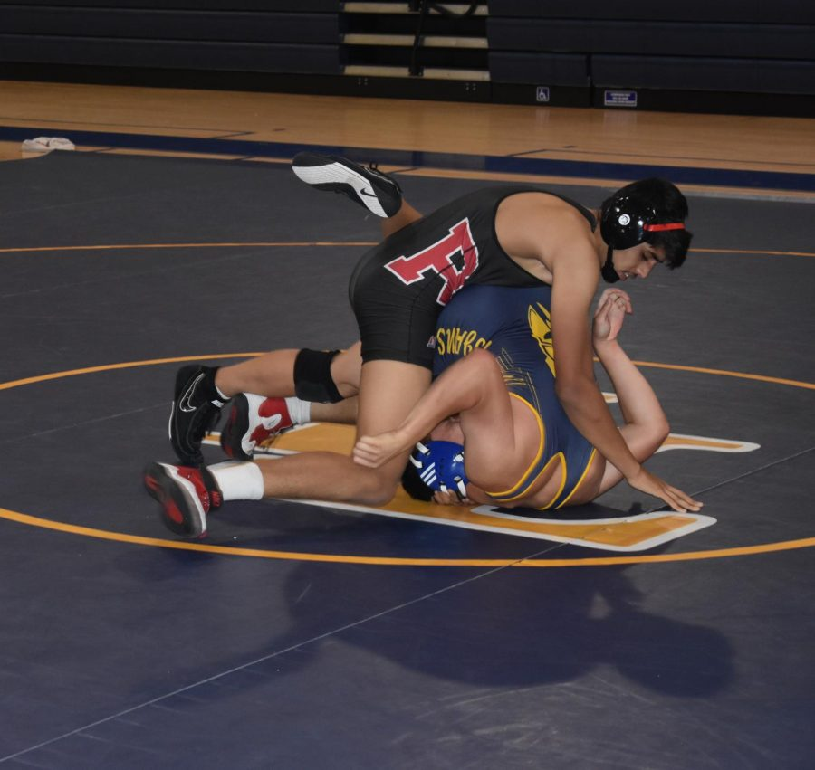 Senior+Wrestler+Muhammad+Adde+attempts+to+pin+his+opponent.