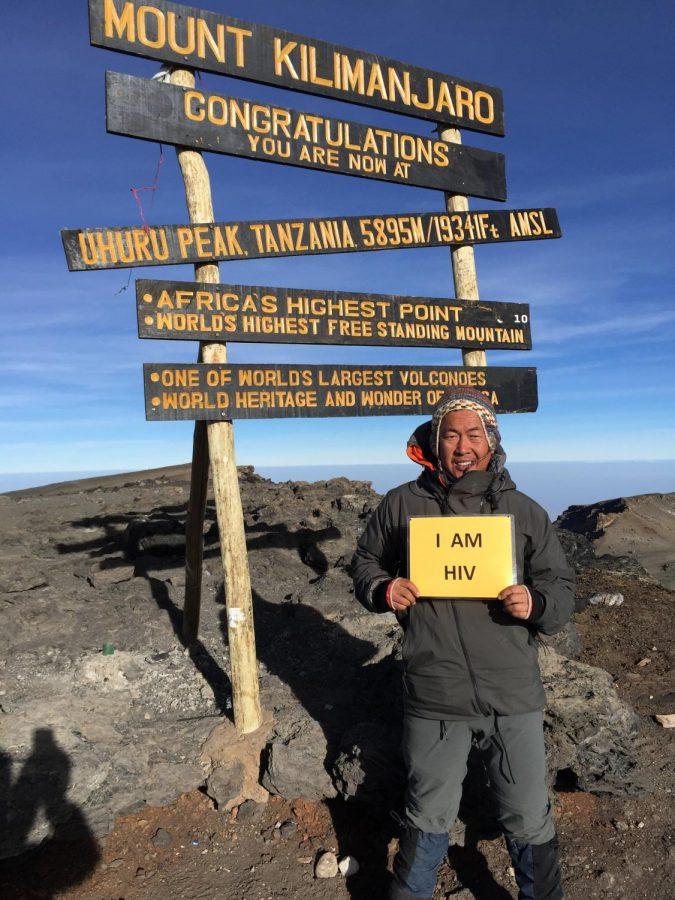 Standing on Mount Kilimanjaro, Garcia proudly smiles with the HIV sign. Photo courtesy of Ferdinand Garcia